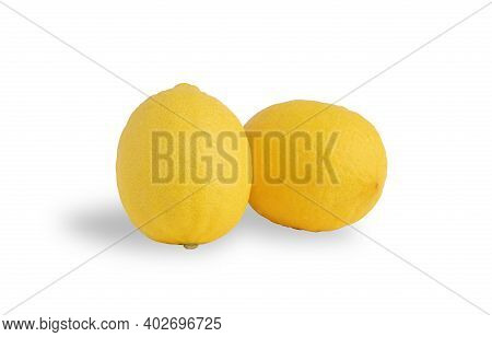 Two Ripe Lemon On The White Background With Clipping Paths. Lemon (citrus Limon) Contains About 5% O