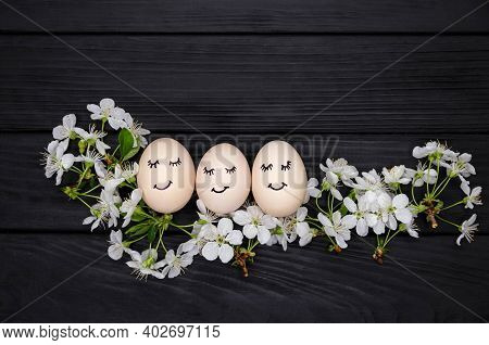 Cute White Easter Egg With A Black Marker Drawn Face Sleep On A Clean Dark Wooden Background. Group