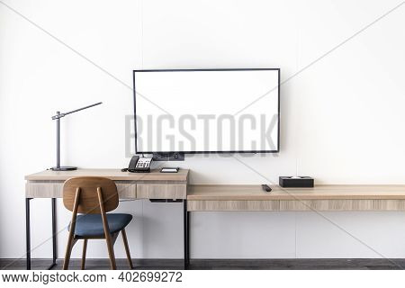 Living Room Interior Led Tv Stand On White Wall Mounted With Wooden Table In The Room In A Modern St