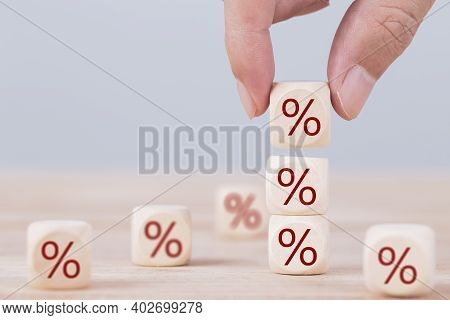 Business Man Chooses A Wood Cube Block On Top With Percent Symbol Icon , Concept Of Financial , Inte
