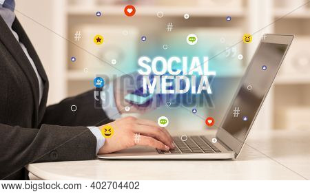 Freelance woman using laptop with SOCIAL MEDIA inscription, Social media concept