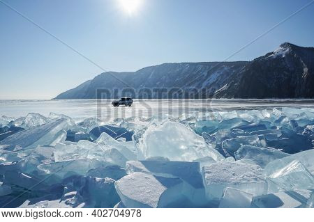 Olkhon Island Russia - 18 February 2019: Frozen Baikal Lake With Big Ice Crystals And 4 Wheel Car In