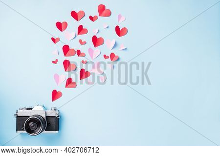 Valentines' Day Background. Vintage Retro Camera And Paper Flying Elements Hearts Cut Greeting Gift