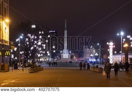 Riga, Latvia - January 14, 2018: Night Winter View Of The Freedom Monument. Is A Memorial Honouring