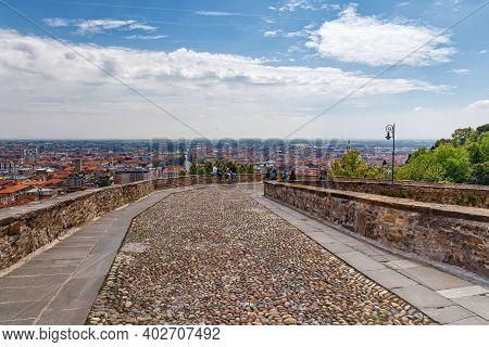 Bergamo, Italy - May 22, 2019: View Of The Old Cobblestone Road From Upper Bergamo (citta Alta). Ber