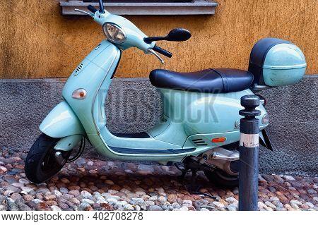 Bergamo, Italy - May 22, 2019: Blue Popular Italian Scooter Vespa On The Street In Bergamo.