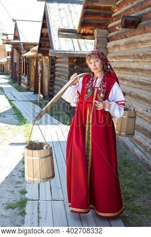 Beautiful Young Woman In Russian Authentic National Red Clothes With Ornament