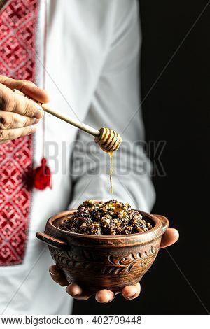 Kutia. Traditional Orthodox Food. Holy Evening. Ukrainian, Belarusian Tradition. Man In Slavic Shirt