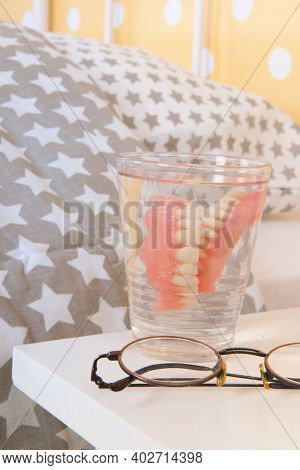 Bedroom old peoples home with false teeth and glasses