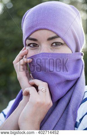 Beautiful Oriental Woman In The National Purple Headscarf. Arab Woman In Traditional Headscarf. A Wo