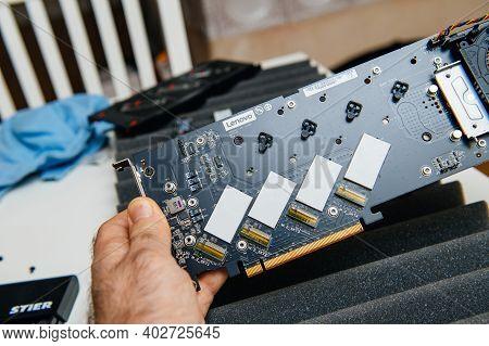 Paris, Frnac E- Dec 20, 2020: Pov Male Hand Holding Lenovo Thinkstation Quad Aic M.2 For Use With Mo