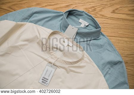 Paris, France - Jan 7, 2021: View From Above Of Two Fashionable Shirts By Cos