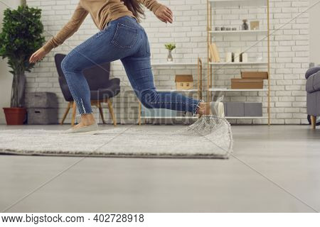 Clumsy Woman Stumbles On The Rug In The Living-room And Falls Down On The Floor