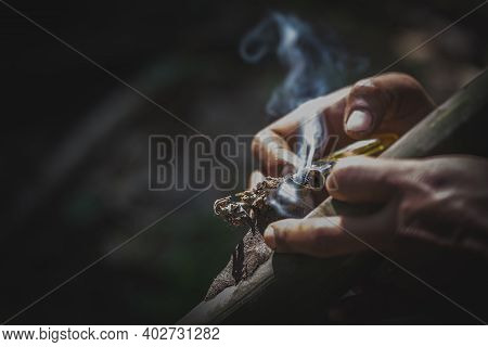 Drug Addicts In The Dark Room. Addict/junkie Preparing Drugs With A Spoon And Lighter. White Powder