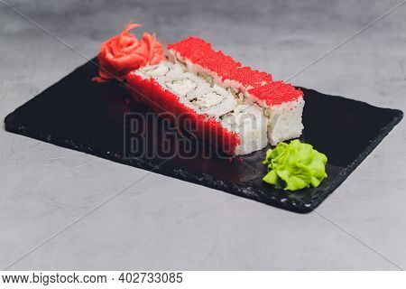Sushi Rolls - Red Dragon With Tobiko Caviar And Salmon. Traditional Japanese Cuisine. Top View.