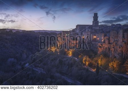 Tuscany, Pitigliano Medieval Village On Tuff Rocky Hill At Blue Hour. Italy, Europe.