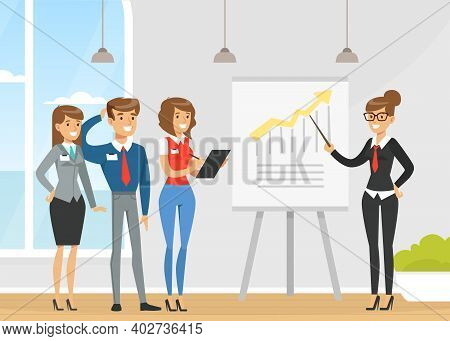 Businesswoman Making Presentation And Explaining Chart On Whiteboard, Business Conference Room With