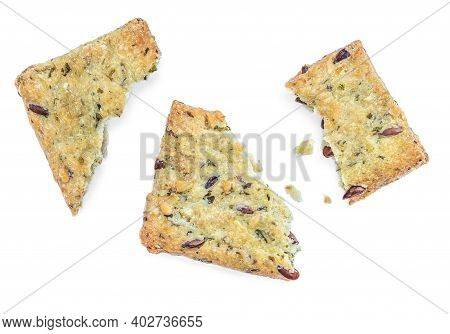 Broken Salted Crackers Isolated On White Background. Crushed Dry Cracker Cookies With Herbs, Top Vie