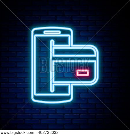 Glowing Neon Line Nfc Payment Icon Isolated On Brick Wall Background. Mobile Payment. Nfc Smartphone