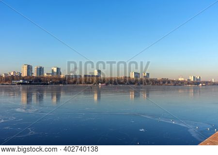 Moscow, Russia - December 4, 2020: People Skate On The Frozen Moscow Canal In Russia. People On The