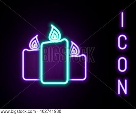 Glowing Neon Line Burning Candles Icon Isolated On Black Background. Old Fashioned Lit Candles. Cyli