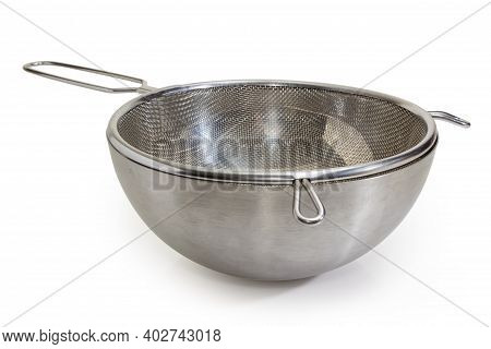Round Stainless Steel Sieve In Stainless Steel Bowl On A White Background, Side View Close-up In Sel