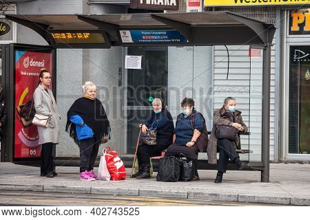 Belgrade, Serbia - October 17, 2020: Old Senior Woman Wearing A Respiratory Face Mask Waiting For Tr