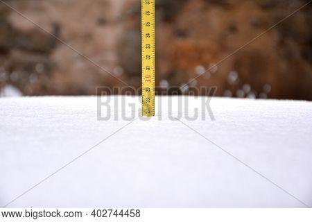 Yellow Tape Measure Measuring Snow Cover After The Storm. Filomena Snow Storm In La Rioja, Spain, Ja