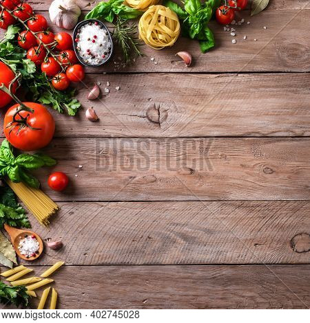 Vegetables And Uncooked Pasta, Cooking Background, Top View, Copy Space. Various Italian Pasta, Toma