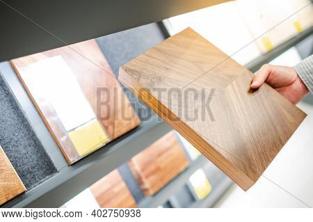 Male Hand Choosing Wooden Cabinet Panel Materials Or Countertops For Built-in Furniture Design. Shop