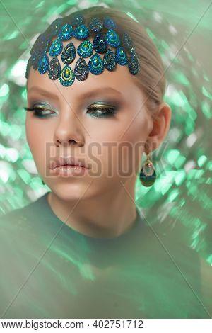 Beautiful Fashion Woman Face. Perfect Blue Green Makeup.