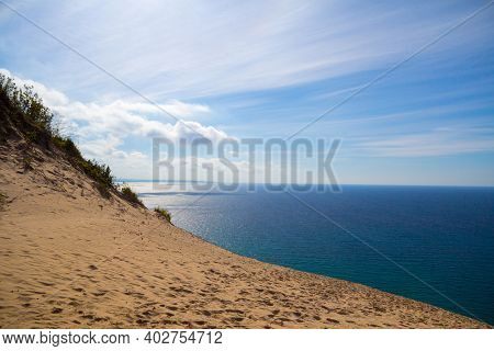 View Of Lake Michigan From The Top Of Sleeping Bear Dunes On A Sunny Summer Day.