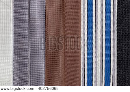 Elastic Band Texture. Close-up Of A Variety Of Colorful Elastic Bands For Clothing And Furniture. Us