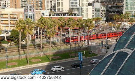 San Diego, California Usa - 30 Jan 2020: Mts Red Trolley And Metropolis Urban Skyline, Highrise Skys