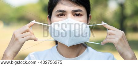 Woman Wearing N95 Respiratory Medical Face Mask Prevent Coronavirus Disease (covid-19) And Pm2.5 (pa