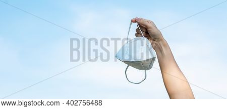 Hand Showing N95 Respiratory Medical Face Mask On Sky Background, Prevent Coronavirus Disease (covid
