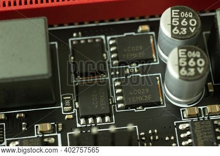 Transistors, Chips And Other Elements On The Motherboard Electric Circuit Close-up.