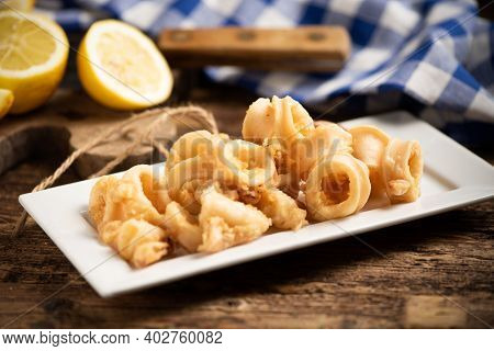 Traditional Italian Fried Calamari And Lemon Slice Close Up