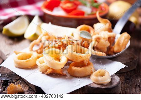 Traditional Italian Fried Calamari And Lemon Slice