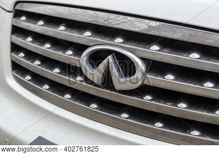 Infinity Logo Close Up On Car Front Part. Infinity Japanese Automobile Manufacturer.  Infinity Is Th