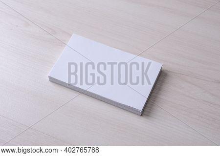 Business Card Blank On Wooden Background. Corporate Stationery, Branding Mock-up. Creative Designer