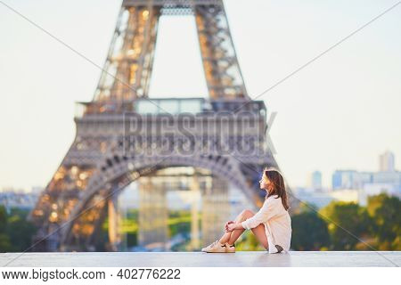 Beautiful Young Woman In Paris Near The Eiffel Tower At Morning. Parisian Girl On Trocadero View Poi