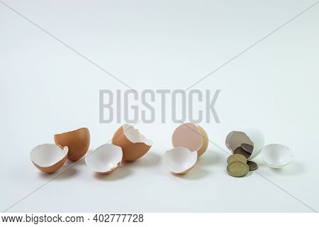 Three Empty Eggs And One Egg With Money. Profitable Investment. Growth Strategy. Pension Savings. In