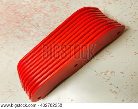 Red Fabricated Pet-g Plastic With Debris Around It From Routing The Edges And With Copy Space.