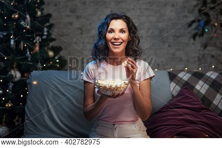 Young Beautiful Woman Stay Home, During Pandemic, Spends His Free Time Watching Tv On Couch At Home,