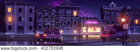 Rainy Street, Wet Weather In Night Town With Cars Going Along Illuminated Road With Lampposts And Cr