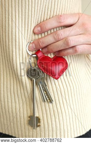 Leather Red Heart Key Trinket As A Valentines Day Gift Closeup Photo On White Sweater Background