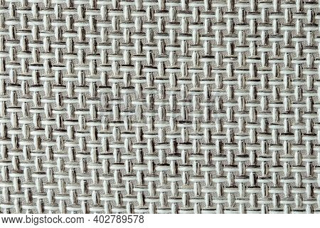 Close-up Of A Textured Fabric. Macro Shot Of Gray Upholstery For Furniture. Wallpaper And Background
