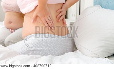 Young Pregnant Woman With Spinal Pain Suffering From Aching Back. Concept Of Pregnancy Healthcare An