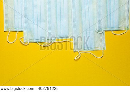 Blue Medical Face Masks On Yellow Background